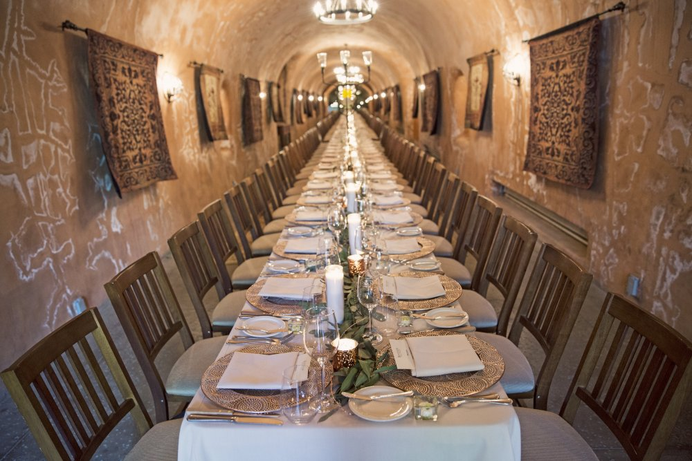 Blue-Spark-Benziger-Winery-Cave-Incentive-Dinner-Beige-Linen-Chargers-Olive-branch-centerpieces
