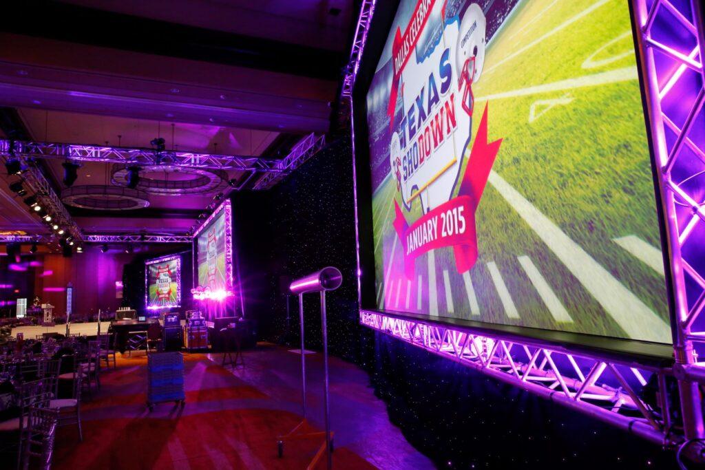Custom stage design and audio visual purple lighting